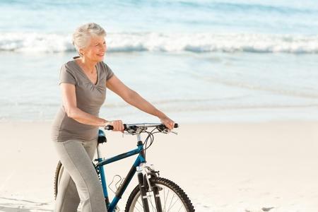 man exercise: Senior woman with her bike Stock Photo