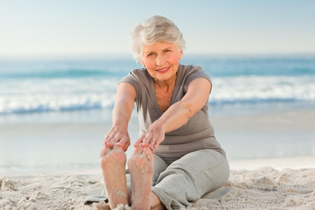 Elderly woman doing her streches photo