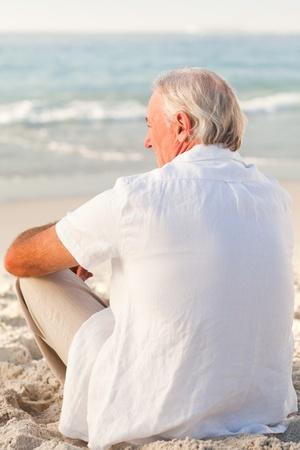 Man sitting on the beach Stock Photo - 10214772