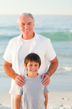 Grandfather and his grandson at the beach Stock Photo - 10214313