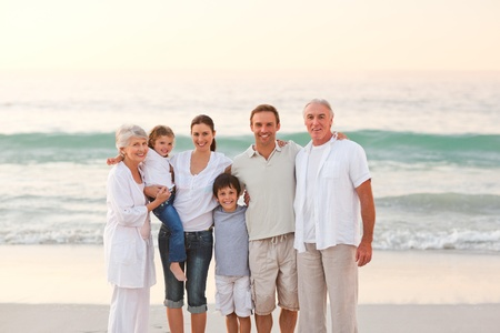 Beautiful family at the beach photo