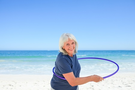 hoops: Senior woman playing with her hoop Stock Photo