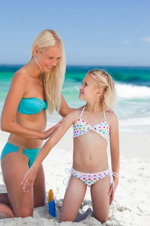 Mother applying sun cream on her daughter Stock Photo - 10216478