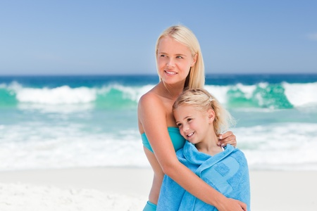 Mother with her daughter in her towel photo