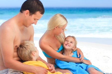 Parents with their children in their towels Stock Photo - 10214585