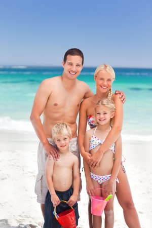 Radiant family on the beach photo