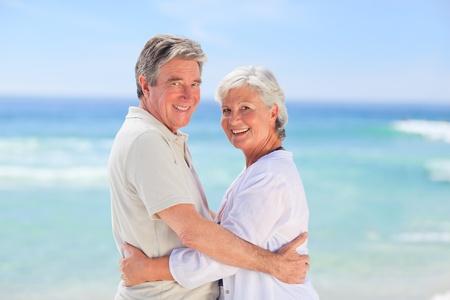 Elderly man embracing her wife Stock Photo - 10213650