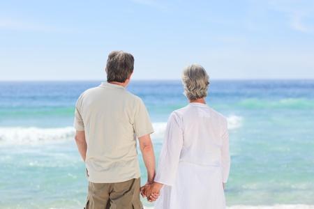 Happy couple on the beach photo