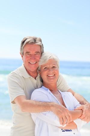 retired couple: Happy couple on the beach Stock Photo