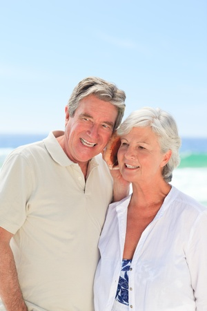 Retired couple listening to their shell photo