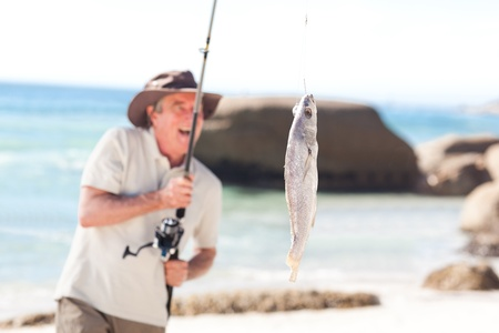 Man fishing at the beach photo