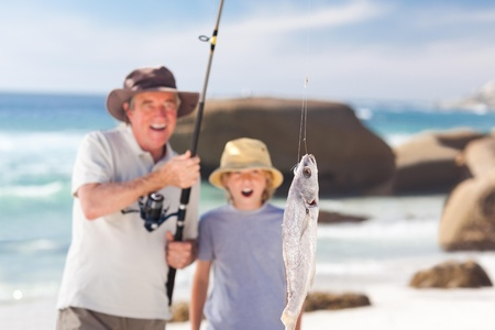 grandfather fishing with his grandson photo