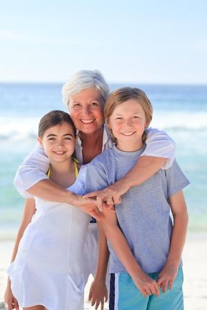 Grandmother with her grandchildren photo