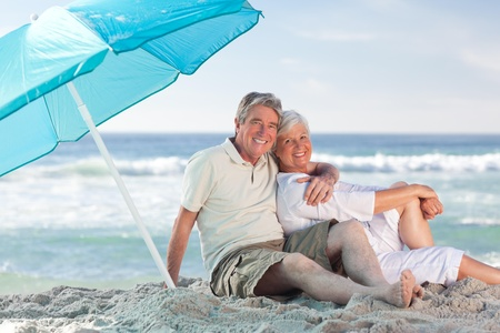 Mature couple on the beach Stock Photo - 10216577