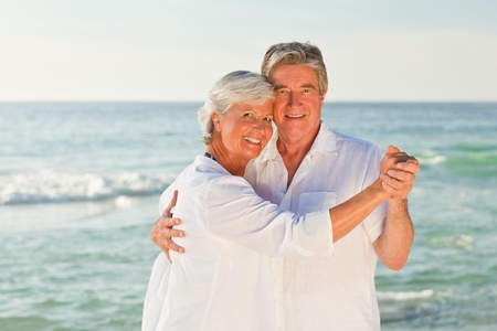 Mature couple dancing on the beach Stock Photo - 10213025