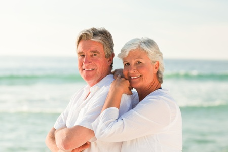 Woman hugging her husband at the beach Stock Photo - 10214606