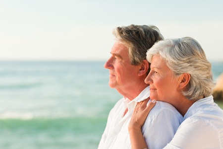 Woman hugging her husband at the beach Stock Photo - 10214593