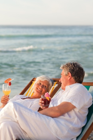 Retired couple drinking a cocktail Stock Photo - 10213721