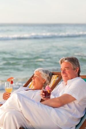 Retired couple drinking a cocktail Stock Photo - 10213166