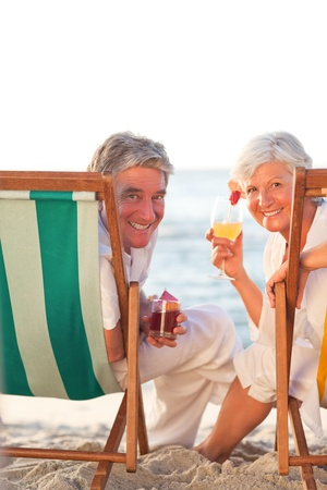 Senior couple drinking a cocktail photo