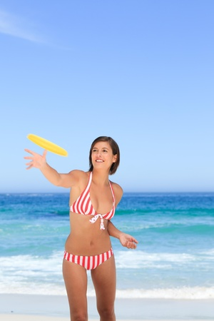 Woman playing frisbee Stock Photo - 10207532