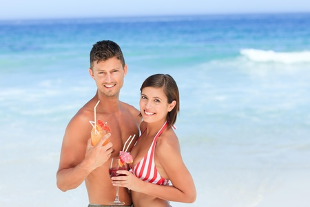 Adorable couple drinking a cocktail photo