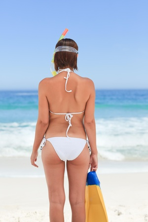 Woman with her mask at the beach photo