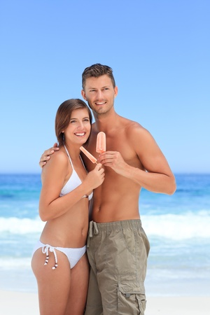 hot wife: Couple eating an ice cream Stock Photo