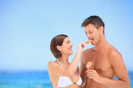 hot wife: Lovers eating an ice cream Stock Photo