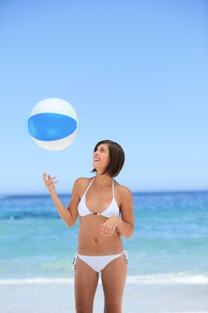 Lovely woman with her ball on the beach photo