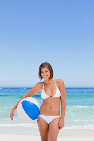 Cute woman with her ball on the beach Stock Photo - 10214459