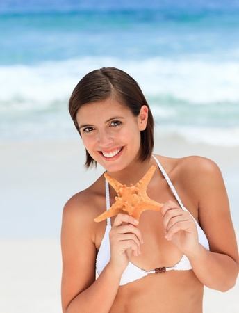 Lovely woman with a starfish photo