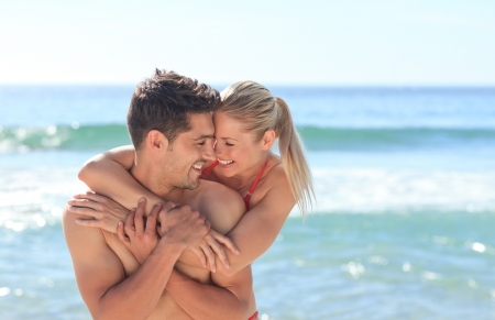 guy on beach: Happy lovers at the beach