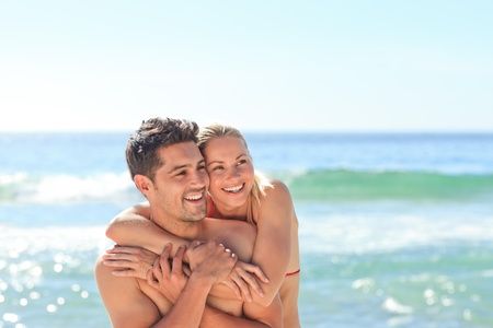 sexy couple on beach: Happy lovers at the beach
