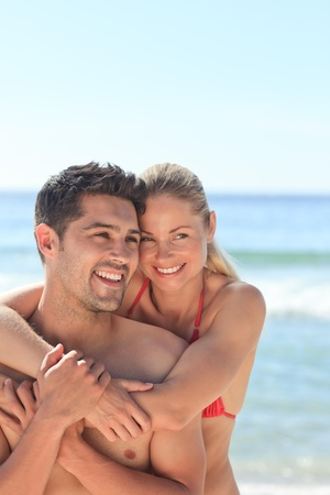 Happy lovers at the beach photo