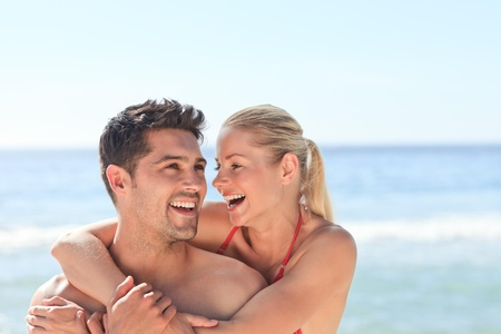 Joyful couple at the beach photo