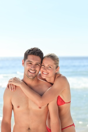 sexy couple on beach: Joyful couple at the beach