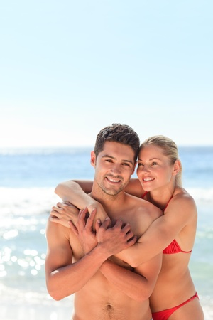 Enamored couple at the beach photo