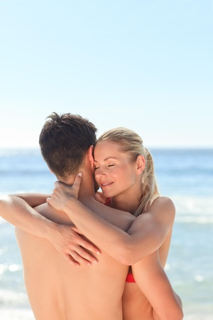 Enamored couple at the beach Stock Photo - 10214347