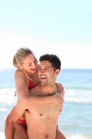 Beautiful man having girlfriend a piggyback photo