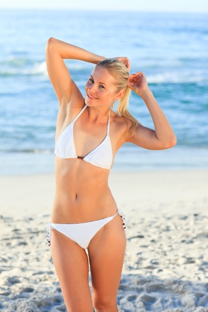 Blonde woman at the beach photo