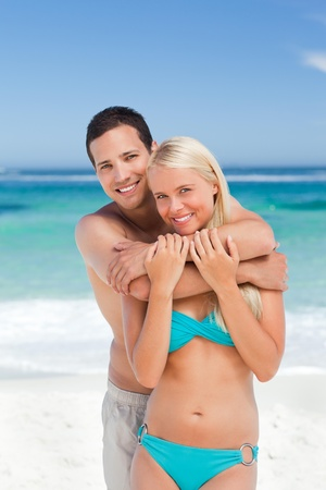 lovers embracing: Enamored couple on the beach