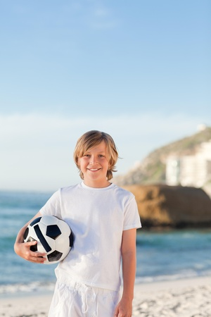 union beach: Little boy with his ball on the beach Stock Photo