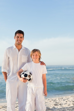 Father and  his son on the beach photo