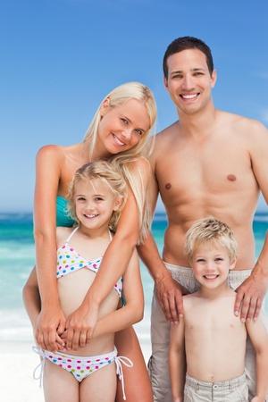 Happy family on the beach photo