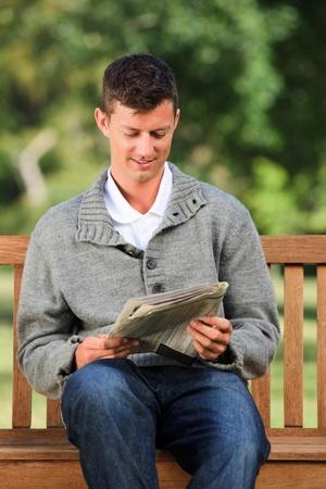 Man making his crossword  Stock Photo - 10218973