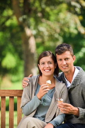 Couple eating an ice cream Stock Photo - 10219500