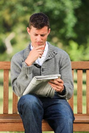 Man making his crossword Stock Photo - 10218617