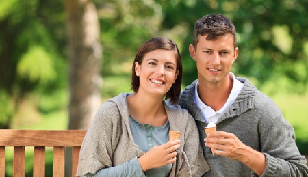 Young couple eating an ice cream Stock Photo - 10217063