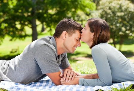 enamored: Enamored couple in the park  Stock Photo